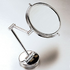Swivel magnified mirror