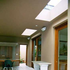 Concrete slab system with skylights above door